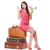 Woman posing with suitcases — Stock Photo