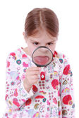 Girl and magnify glass — Stock Photo