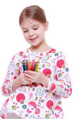 Girl with colored pencils — Stock Photo