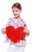 Young girl with huge red heart — Stock Photo