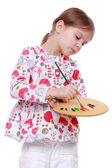 Cute little girl painting — Stock Photo