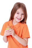 Little girl holding an egg — Stockfoto