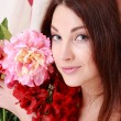 Young girl with flowers — Stock Photo #40729613