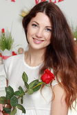 Girl holding red rose — Stock Photo