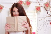 Girl holding vintage book — Stock Photo
