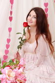 Red rose with smiling romantic girl — Stock fotografie
