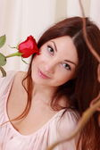 Red rose with smiling romantic girl — Stock Photo