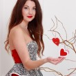 Beautiful girl decorates branches — Stock Photo #40731187