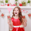 Foto Stock: Girl over Valentine's day background