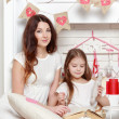 Mother and her daughter over Valentine's Day interior — Stock Photo #40735517