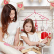 Mother and her daughter over Valentine's Day interior — Stock Photo #40735519