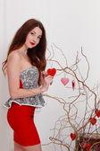 Beautiful girl decorates branches — Stockfoto