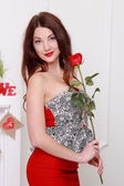 Pretty girl with red rose — Stock Photo