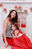 Mother and her daughter over Valentine's Day interior — Stock Photo
