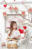 Girl over Valentine day background — Zdjęcie stockowe
