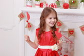 Girl over holding hearts — Stock Photo