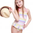 Girl in a swimsuit and a straw hat — Stock Photo #41787085