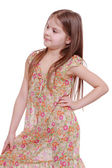Girl in flowered dress — Stock Photo