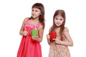Girls with red and green cup — Stock Photo
