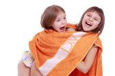 Girls holding towel — Stock Photo