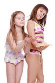 Girls holding starfish and shell — Stock Photo