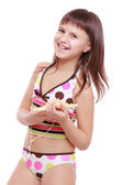 Girl in a swimsuit holding a starfish — Stock Photo