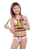 Little girl holding colorful pencils — Stock Photo