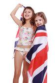 Girls in swimsuit holding British flag — Stock Photo