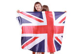 Girls in swimsuit holding British flag — Stock Photo