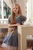 Girl at tea — Stock Photo