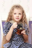 Girl with an old coffee grinder — Stock Photo