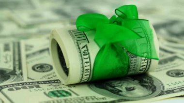 Dollar bills with green ribbon — Vídeo de stock