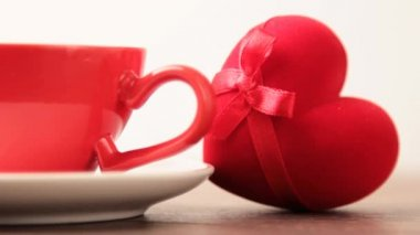 Coffee cups and heart-shaped box — Stock Video