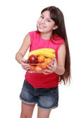 Girl holding fruit bowl — Stock Photo