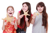 Girls holding starfishes — Stock Photo
