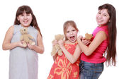 Girls holding toy bear — Stock Photo
