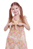 Girl holding a starfish — Stock Photo