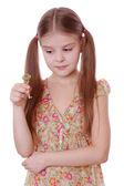 Girl holding golden vintage old key — Stock Photo