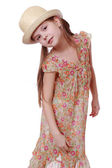 Little girl in summer dress and straw hat — Stock Photo