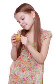 Girl holding a chicken egg — Stock Photo