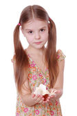 Little girl holding sea shell in her hands — Stock Photo