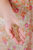 Girl holding vintage key — Foto de Stock
