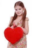 Meisje bedrijf rood hart — Stockfoto