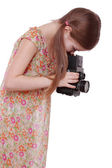 Girl holding vintage photo camera — Stock Photo