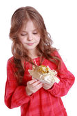 Girl holding angel doll — Stock Photo
