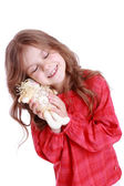 Little girl holding angel doll — Stock Photo