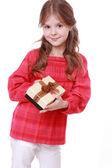 Smiling girl holding present — Stock Photo