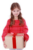 Smiling girl holding present — Stock Photo