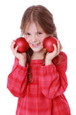 Little girl holding red decorative balls — Stock Photo