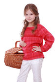 Little girl holding a picnic basket — Stock Photo